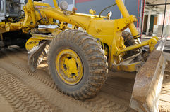 Road grader. Front part of working road grader Stock Photos
