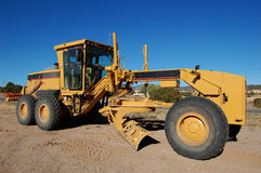 Road Grader. Big yellow road grader used for road construction stock images