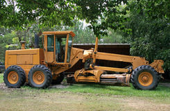 Road grader. Big orange road grader, very heavy road equipment Royalty Free Stock Images