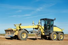 Road grader bulldozer Stock Images