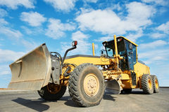 Road grader bulldozer. Over blue sky at work outdoors Royalty Free Stock Images