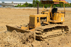Road grader bulldozer at site Royalty Free Stock Photo