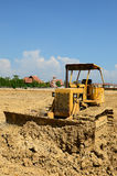 Road grader bulldozer at site Stock Photos