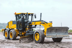 Road grader - heavy earth moving dirty Royalty Free Stock Image