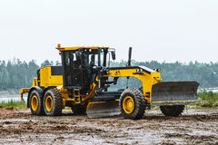 Road grader - heavy earth moving dirty. Road grader - heavy earth moving on dirty ground Royalty Free Stock Photography