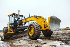 Road grader - heavy earth moving dirty. Road grader - heavy earth moving on dirty ground Stock Images