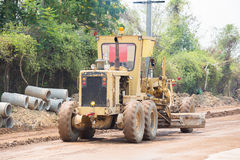 road grader at work on road construction site Royalty Free Stock Images