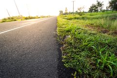 the road and the grass stock photography