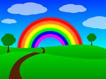 Road Through a Grassy Field with a Rainbow Stock Photography