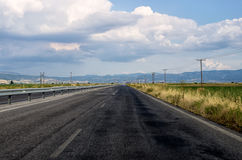 Road in Greece on a cloudy day Royalty Free Stock Photography