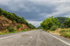 Road in Greece on a cloudy day Stock Photo