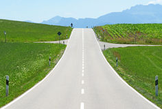 Road in green countryside Royalty Free Stock Image