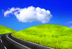 Road and green field Royalty Free Stock Photography