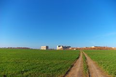 Road through green field. Photo of the road through green field Royalty Free Stock Photography