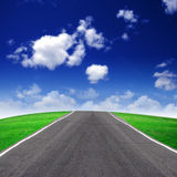 Road and green field Royalty Free Stock Photo