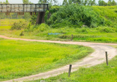 Road on green grass  field Royalty Free Stock Photo