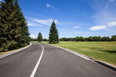 Road and green grass lawn Royalty Free Stock Images
