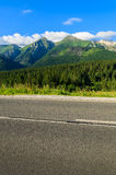 Road in green summer landscape of Tatra Mountains in Zdiar village, Slovakia Stock Image