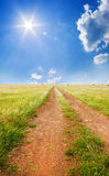 Road on green summer meadow. Royalty Free Stock Photography