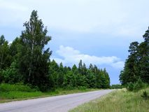 Road, green trees and beautiful cloudy sky, Lithuania Stock Photos