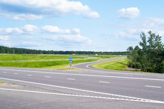 Road, gren grass and blue sky Royalty Free Stock Photo