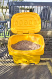 Road grit. Open container of grit for roads in icy weather in the UK Royalty Free Stock Image