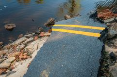 Fallen Road. A road that had been devastated from a flood royalty free stock images