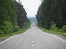 The road has asphalt and two lanes. royalty free stock photo