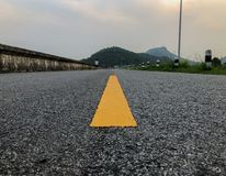 The road that has yellow stripe on middle with natural backgroun stock photo