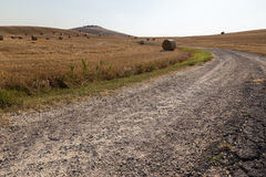 Road and haybales royalty free stock images