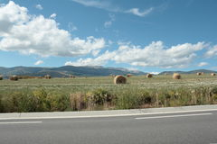 Road and haystack in cerdagne, Pyrenees. Languedoc region of france royalty free stock image