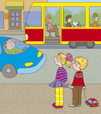 Road hazard. Boy and a girl think if you can go to the tram in front of the car Royalty Free Stock Photos