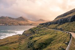 A road heading to the town of eidi in the faroe islands. This picture shows a road heading to the town of eidi in the faroe islands Royalty Free Stock Photos