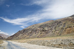 Road among high altitude mountains Stock Images