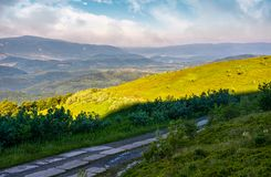 Road in high mountains in summer morning. Beautiful nature scenery Royalty Free Stock Photography