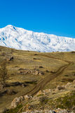 Road in the High snow-capped mountains. Altai Stock Photography