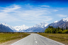 Road in high snow mountains Royalty Free Stock Image