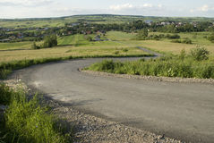 Road in highlands. Curved road in highlands landscape Royalty Free Stock Image