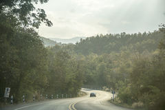 Road Highway around forest Background. Travel in Thailand. Stock Photos