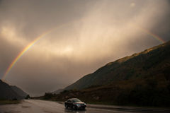 Road highway car speed mountains cloudy rainbow travel stock image