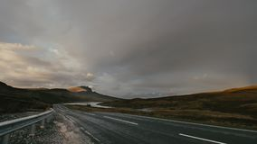 Road highway in highland, Scotland - Old Man of Storr, time-lapse. Wide angle stock footage