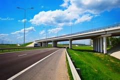 Road highway junction. Road junction with bridge overpass under highway Stock Photo
