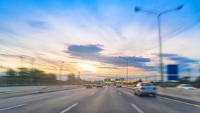 On the road in highway light traffic with sunset at motorway. To Bangkok, Thailand stock images