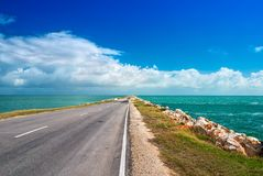 Road highway route leaving in ocean bulk man-made artificial dam from island of Cuba to Cayo Guillermo Royalty Free Stock Image
