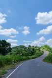 Road, hill and blue sky. Road along the hill and blue sky background Royalty Free Stock Photography