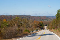 Road through the hills. A two lane highway through the Ozark mountains royalty free stock image
