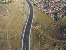 Road through hills aerial photography Royalty Free Stock Image