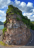 Road between hills at the lake. Mauritius. Royalty Free Stock Photos