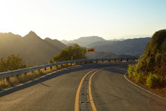Road through the hills in Malibu at sunset. California Royalty Free Stock Photography