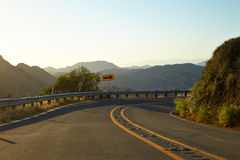 Road through the hills in Malibu at sunset. California Royalty Free Stock Photo